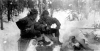 Sgt Barrett & Cpl Bourg stop for lunch near Dry Creek, Alaska,  Feb 7, 1943.
