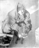 Pvt   ?    , with Aleutia, Malamute Pup, Dry Creek, Alaska, Feb. 1943.