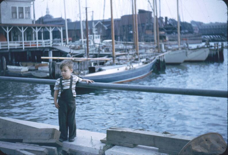 Joe and boats in harbor. Newport, R.I. Sept 1952.