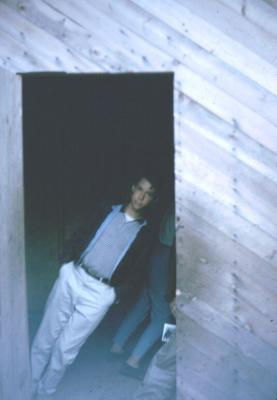 Joe in door at magnetic craters New Brunswick. The house was built askew as a tourist attraction.