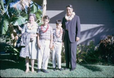Charlotte, Joe, Charlie, F.M. leaving Honolulu. Dec 1961.