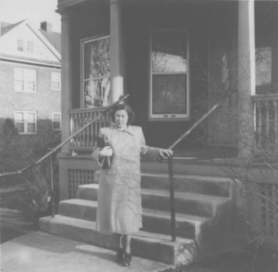 Mom in front of rented home in Syracuse.