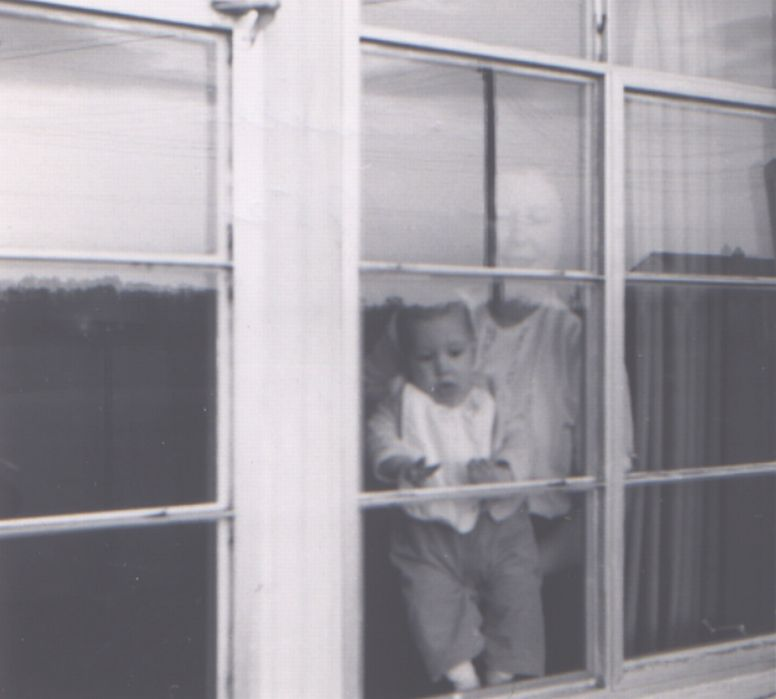 Charlie with mom in the window in Baldwinsville.