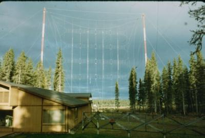 Short Wave radio station KNLS Transmitter Building and Curtain Antenna, the goal of the construction project, as completed in 19